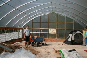 "Dad visiting the ""hoop"" green house on my sister's Springfed Farm."